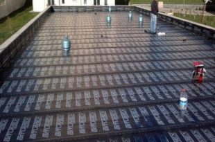 Flat roof pitch construction